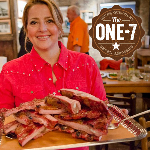 Elizabeth Karmel shows off a tray of succulent spare ribs at Hill Country Barbeque Market.
