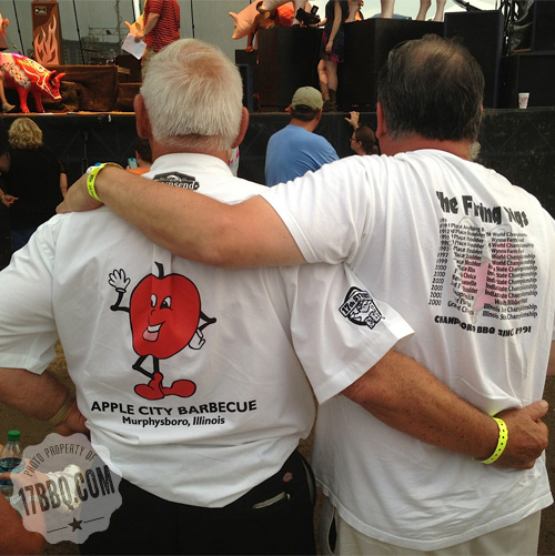 Mike and his nephew, Chris Mills of the Flying Pigs BBQ team, share a moment during the awards ceremony.