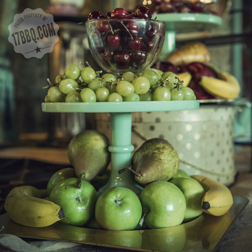 fresh fruit on a tiered jadeite stand
