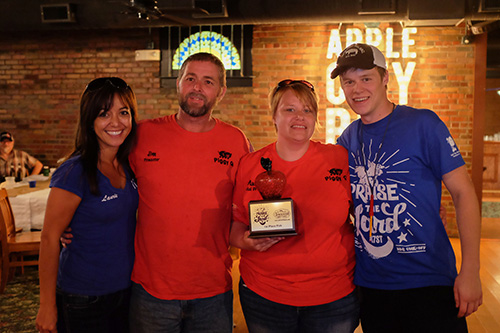 Laurie Neef and Trent Cannon with Maura & Jim Lee of Piggy Q, winners of the fish contest. Photo © Rob Burke
